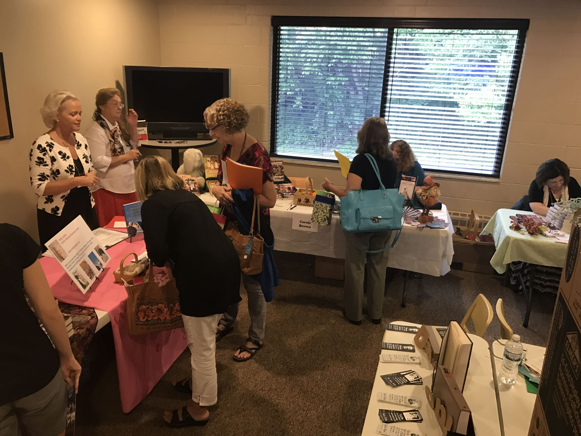 Authors and writers networking at the event.